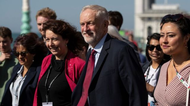 BRIGHTON, ENGLAND - SEPTEMBER 21: Labour leader, Jeremy Corbyn and Brighton Council leader, Nancy Platt walk with young party members along Brighton Promenade for a staged arrival picture ahead of the 2019 Labour Party Conference on September 19, 2019 in Brighton, England. Labour return to Brighton for the 2019 conference against a backdrop of political turmoil over Brexit. (Photo by Dan Kitwood/Getty Images)