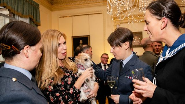 Carrie Symonds with Dilyn the dog at a military reception in Downing Street