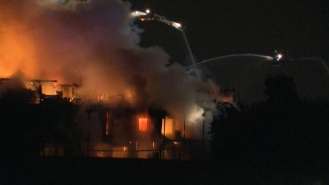 Firefighters are battling a major blaze at a four-storey block of flats in southwest London.