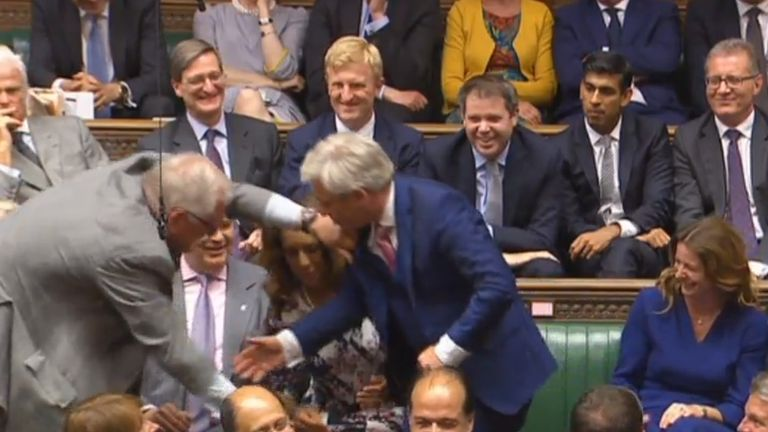 John Bercow is dragged to the speaker's chair by MPs after he was reelected as Speaker of the House of Commons, London, during its first sitting since the election.