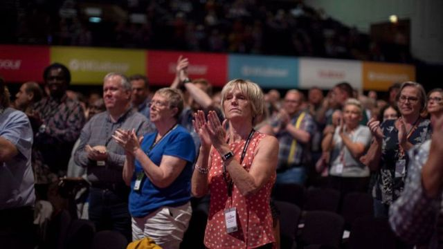 Labour members applaud a speech on day two of the party's conference in Brighton