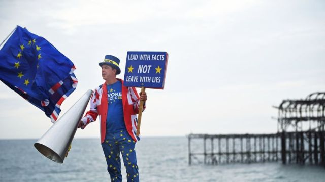 An anti-Brexit protester on Brighton beach during the Labour Party Conference