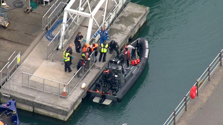 Migrants disembark after being rescued in the English Channel