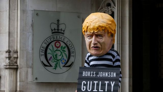 A protester dressed as Boris Johnson outside The Supreme Court