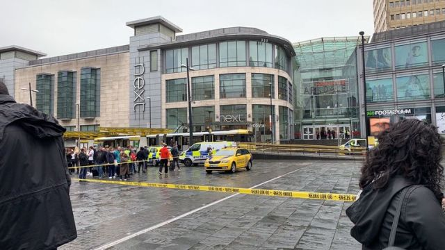 Police vehicles outside the Arndale Centre in Manchester