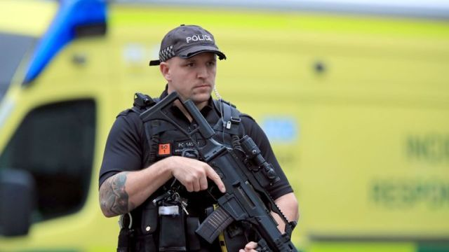 An armed police officer outside the Arndale Centre in Manchester