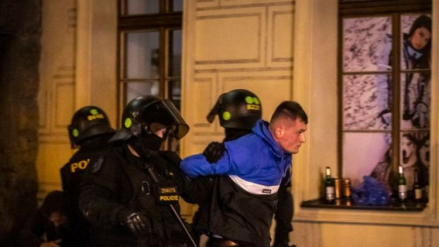 PRAGUE, CZECH REPUBLIC - OCTOBER 11: England fans detained by police in Prague ahead of the European Championship qualifying match between Czech Republic and England on October 11, 2019 in Prague, Czech Republic. (Photo by Gabriel Kuchta/Getty Images)