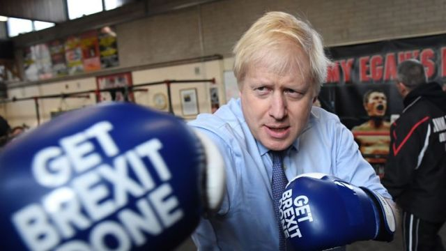 Boris Johnson during a visit to Jimmy Egan's Boxing Academy at Wythenshawe