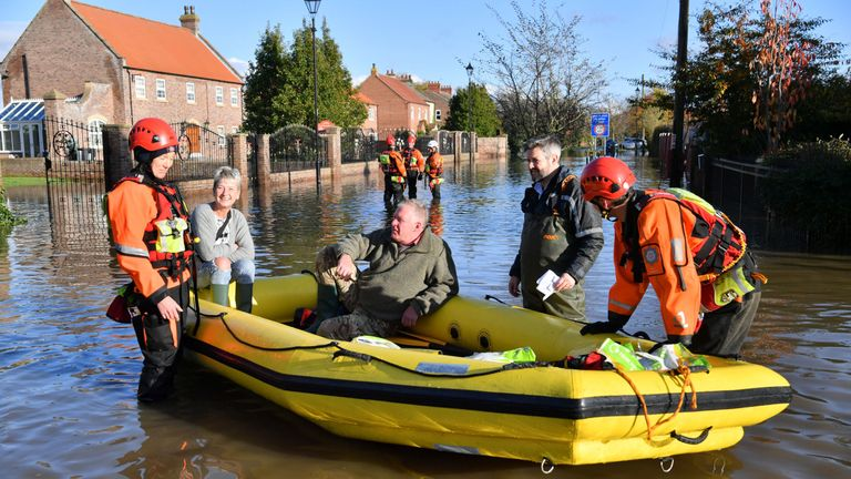 Fire and rescue crews transport people through floodwater to other parts of Fishlake, Doncaster