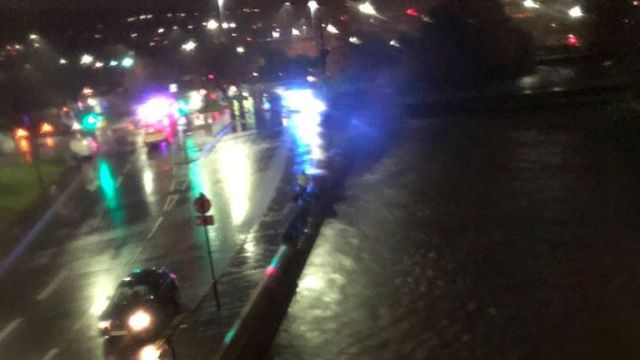 The River Don has risen close to bursting next to a busy road. Pic: Hannah Crossley