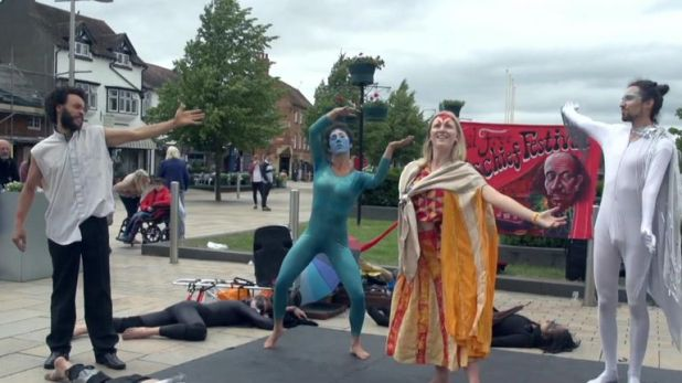 Climate change protesters demonstrating outside the RSC building in Stratford-upon-Avon