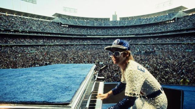 Elton John performing at Dodger Stadium in Los Angeles in 1975. Pic: Terry O'Neill/Iconic Images