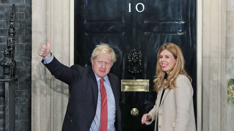 Boris Johnson and girlfriend Carrie Symonds arrive at 10 Downing Street after the Conservative victory
