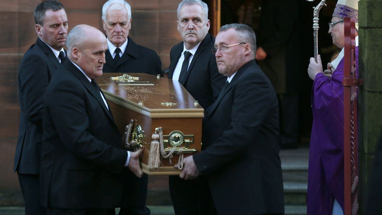 A coffin leaves the church after the funeral of Erin McQuade and her grandparents