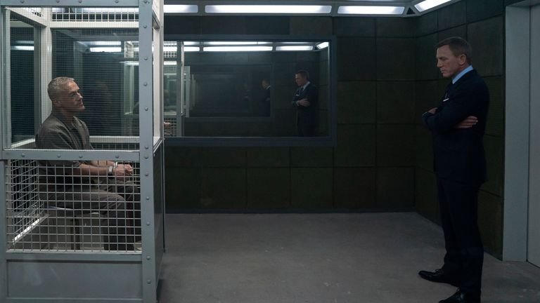 James Bond (Daniel Craig) visits Blofeld (Christoph Waltz) in his prison cell in No Time To Die