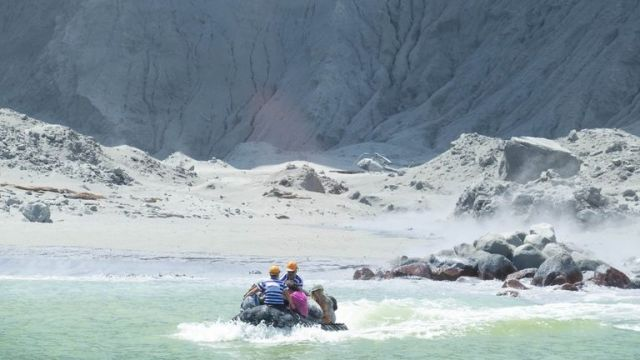 Tour guides evacuate the island after the eruption. Pic: Twitter/ @sch