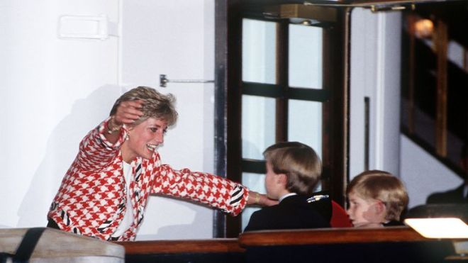 The Princess of Wales greets her sons Prince William and Prince Harry on the deck of the yacht Britannia in Toronto, when they joined their parents on an official visit to Canada, 23rd October 1991. The Princess is wearing a Moschino suit.   (Photo by Jayne Fincher/Princess Diana Archive/Getty Images)
