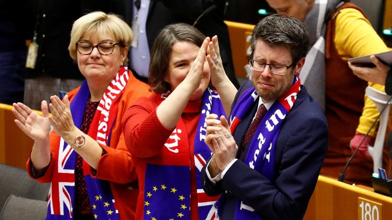 Pro-Remain MEPs burst into a rendition of Auld Lang Syne after the withdrawal agreement was approved