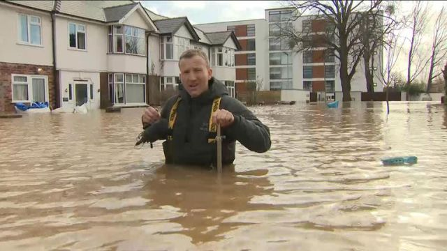 Sky's Alex Rossi up to his waist in flood water on a Hereford street