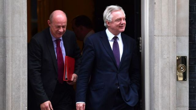 BRITAIN-POLITICS British Work and Pensions Secretary Damian Green (L) and British Secretary of State for Exiting the European Union (Brexit Minister) David Davis leave the weekly cabinet meeting at 10 Downing street in London on November 23, 2016. Britain today delivers a first budget since the Brexit referendum, with government hopes of trimming austerity hampered by financial uncertainty surrounding the country's EU exit strategy. / AFP / BEN STANSALL (Photo credit should read BEN STANSALL/AFP
