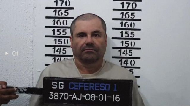 """Clad in a beige uniform marked """"3870,"""" the captured drug kingpin answered the Mexican prison guard's questions calmly, barely looking up as he scrubbed black fingerprint ink from his hands."""