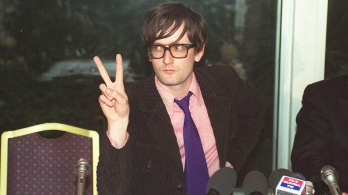 Jarvis Cocker, British pop singer member of the pop group & # 39; Pulp & # 39;, photographed at a press conference following a court appearance where he was informed that he will not be prosecuted for his lovemaking during Michael Jackson's performance at the Brit Awards