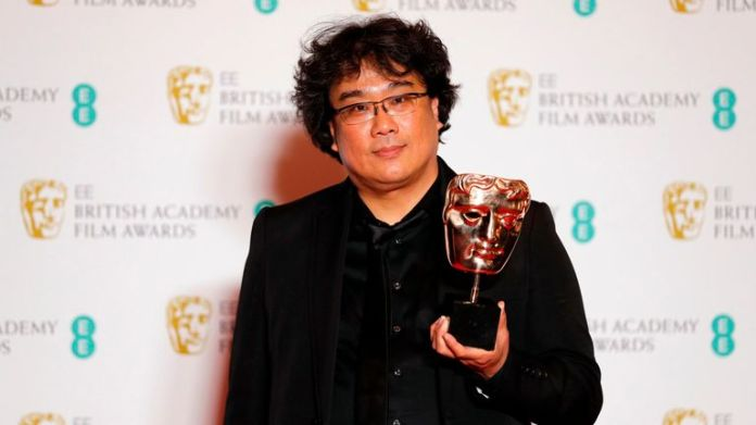 South Korean director Bong Joon-ho poses with their award for a Film Not In The English Language for 'Parasite' at the BAFTA British Academy Film Awards at the Royal Albert Hall in London on February 2, 2020