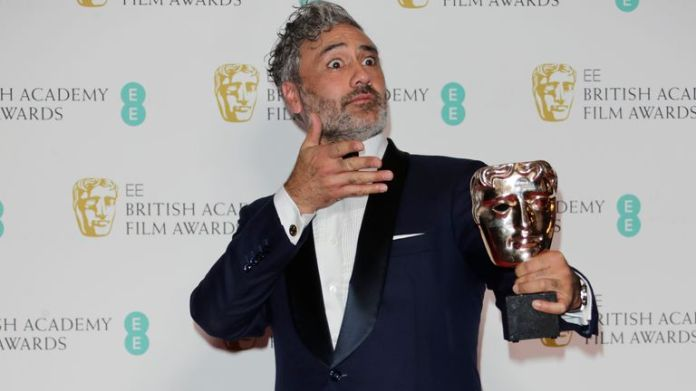 "LONDON, ENGLAND - FEBRUARY 02:   Taika Waititi, winner of the Best Adapted Screenplay award for ""Jojo Rabbit"", poses in the Winners Room at the EE British Academy Film Awards 2020 at Royal Albert Hall on February 2, 2020 in London, England. (Photo by David M. Benett/Dave Benett/Getty Images)"