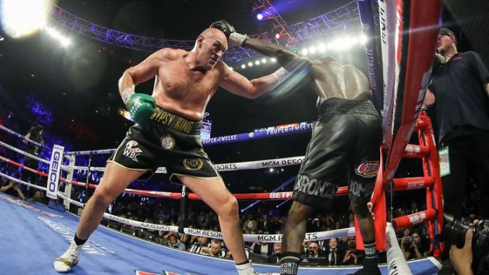 LAS VEGAS, NEVADA - FEBRUARY 22: Tyson Fury (R) punches Deontay Wilder during their Heavyweight bout for Wilder's WBC and Fury's lineal heavyweight title on February 22, 2020 at MGM Grand Garden Arena in Las Vegas, Nevada. (Photo by Al Bello/Getty Images)