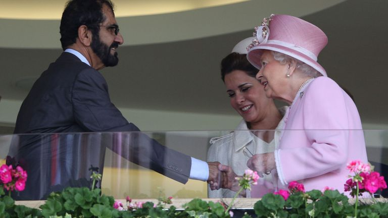Britain's Queen Elizabeth II (R) greets Sheikh Mohammed and Princess Haya in 2016