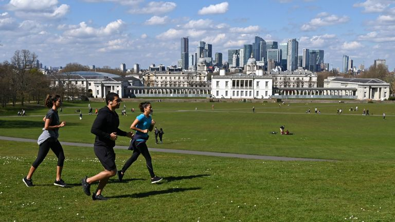 People take their exercise in Greenwich Park in south London