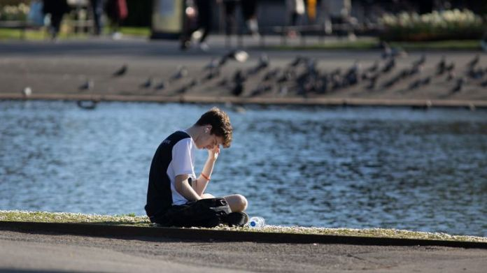 London, ENGLAND - April 04: A man reads by the lake in Regents Park on April 04, 2020 in London, England. The coronavirus pandemic (COVID-19) has spread to many countries around the world, killing more than 60,000 and infecting more than one million people. (Photo by Jo Hale / Getty Images)