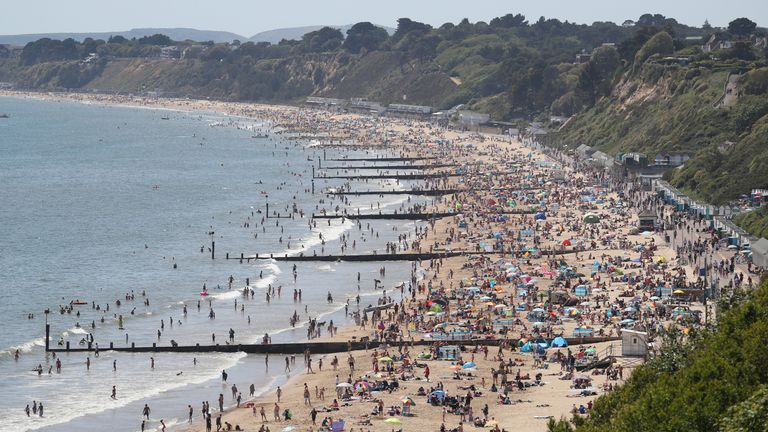 People enjoy the hot weather on Durley and Alum Chine beaches in Dorset, following the introduction of measures to bring the country out of lockdown.