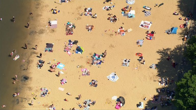 Social distancing was still visible, mostly, as people spent time in parks and at beaches in the sunshine