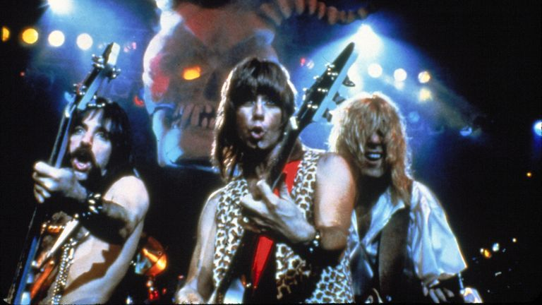 F6F9GH RELEASE DATE: March 2, 1984   MOVIE TITLE: This Is Spinal Tap   DIRECTOR: Rob Reiner  STUDIO: Spinal Tap Prod.   PLOT: In 1982 legendary British heavy metal band Spinal Tap attempt an American comeback tour accompanied by a fan who is also a film-maker. The resulting documentary, interspersed with powerful performances of Tap's pivotal music and profound lyrics, candidly follows a rock group heading towards crisis, culminating in the infamous affair of the eighteen-inch-high Stonehenge stage prop   PICTURED: MICHAEL MCKEAN as David St. Hubbins, CHRISTOPHER GUEST as Nigel Tufnel and HARRY SHEAR
