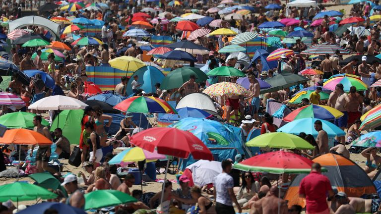Crowds have flocked to Bournemouth's beaches in the hot weather
