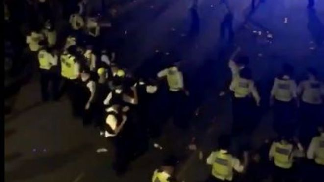 15 police officers were injured during the confrontation with those at a street party