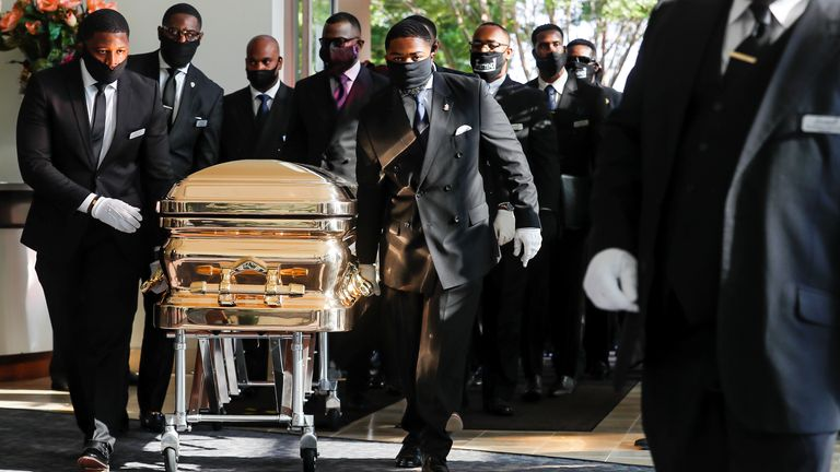Pallbearers bring the coffin into the church for the funeral for George Floyd, outside The Fountain of Praise church in Houston, Texas, U.S., June 9, 2020. Godofredo A. Vasquez/Pool via REUTERS