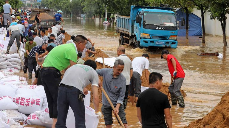 Residents have been putting up makeshift flood defences