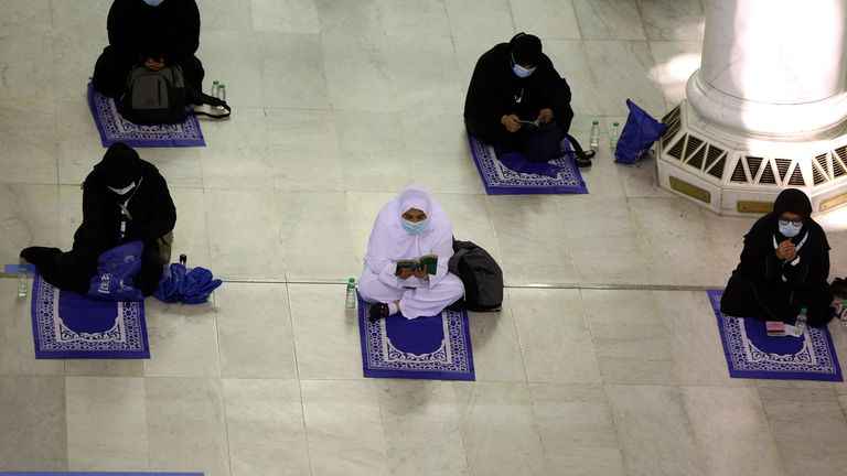 Socially-distanced pilgrims pray at the Grand Mosque in Mecca