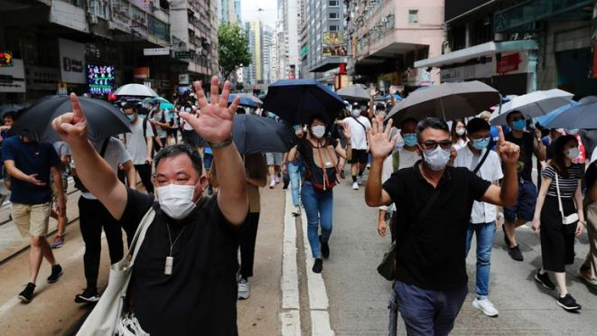 Anti-national security law protesters march at the anniversary of Hong Kong's handover to China from Britain in Hong Kong, China July 1, 2020. REUTERS/Tyrone Siu
