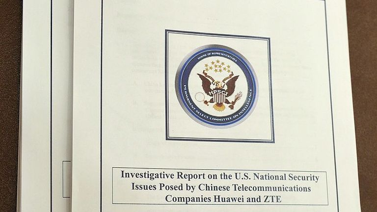 """Copies of the """"Investigative Report on the US National Security Issues posed by Chinese Telecommunications Companies Huawei and ZTE"""" are seen on a table during a press conference to announce their release October 8, 2012 in the House Visitors Center of the US Capitol in Washington, DC. AFP PHOTO/Mandel NGAN (Photo credit should read MANDEL NGAN/AFP/GettyImages)"""