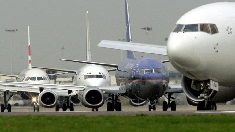 Aircraft queuing for take-off at Heathrow Airport.