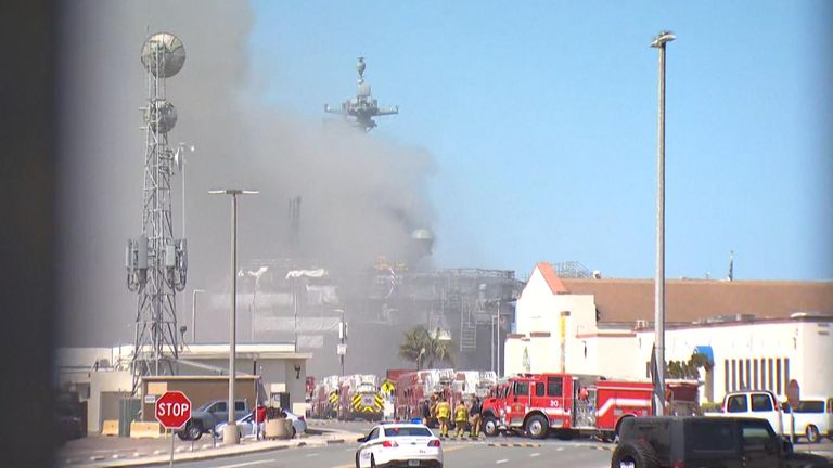 Firefighters battled through thick smoke on the USS Bonhomme Richard in San Diego
