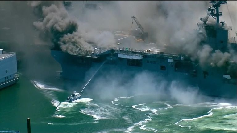 Smaller boats were trying to hose down the fire on the ship