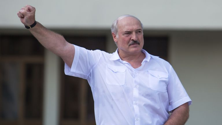 Belarusian President Lukashenko gestures during a rally of his supporters in Minsk