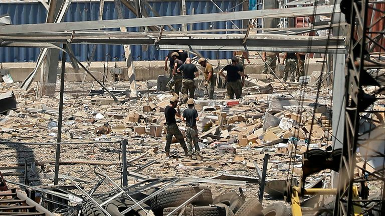 Rescuers and civil defence search through the debris at Beirut port