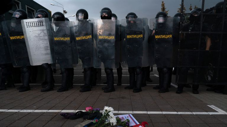 Riot Police stand guard at the Palace of Independence, Lukashenko working residency as hundreds of thousands march towards them.