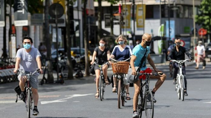 Cyclists wear face masks in Antwerp after tightening of lockdown measures