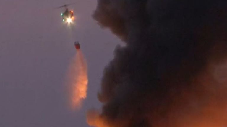 Chopper drops water on scene of Beirut explosion